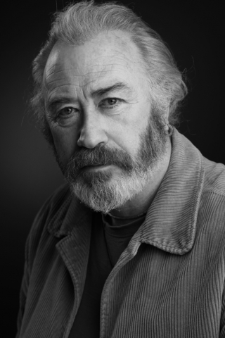 headshot of actor Frank Jakeman using Elinchrom lighting in Black and white