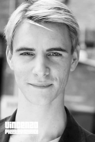 Black and white photo headshot taken in  London outdoor setting Harry Lloyd © Vincenzo Photography