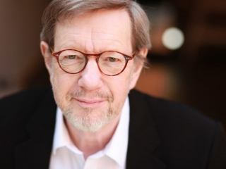 actor Mike grady headshot wearing glasses and a white beard