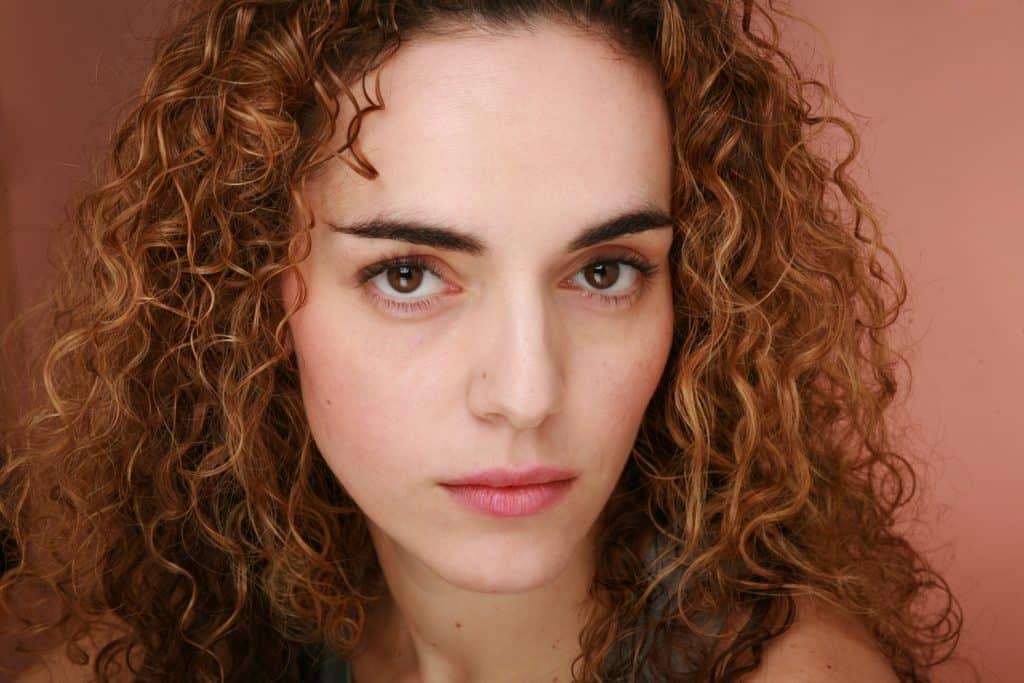 Headshot of Italian actress O'ar Pali keen in studio using studio light