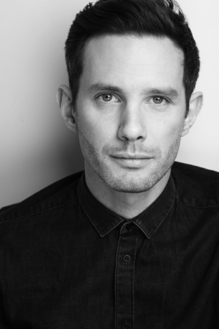 Headshot in black and white of Simon Haydock