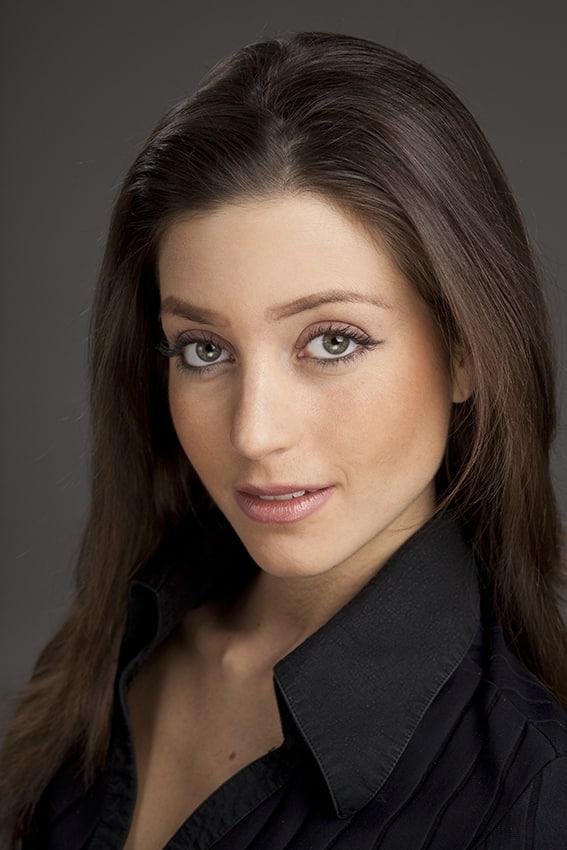 Model Erica Catrina Svensson in black shirt looking at photographer in studio
