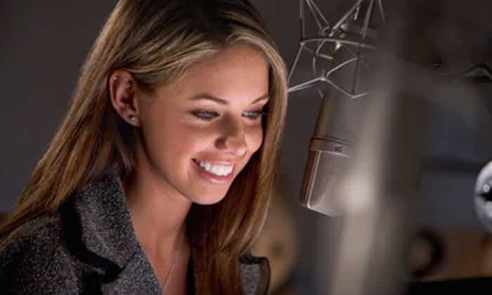 A voice over actor working in the studio